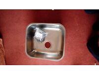 Stainless steel kitchen sink with waste
