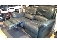 Elecronic double green leather reclining sofa.