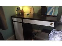 Chest of drawers, desk and desk chair.