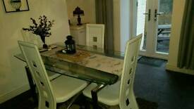 Glass extendable table and 4 high back chairs