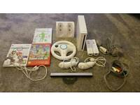 Nintendo Wii with 3 games 2 controllers, steering wheel