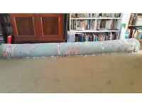 Light green, large oriental rug with floral pattern in good condition