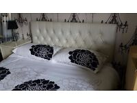 white leather effect double bed
