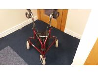 Rollator walking aid with storage bag