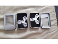 2 metal flash fidget spinners