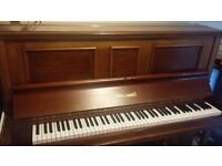 Russel and Russel antique mahogany piano