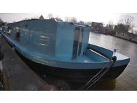 Solar powered wide beam house boat