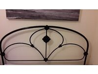 Antique black metal double bed frame and mattress