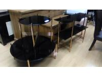 3 black glass tables