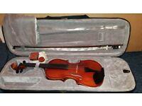 Full size (4/4) violin + 2 optional music books