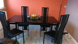 black glass extendable table and 4 chairs