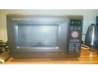 PRICE NEGOTIABLE SHARP Microwave Oven Compact Touch Control 20L R3556 8 Programmes in Brown