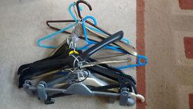 assorted plastic clothes hangers