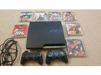 PS3 Slim with 2 controllers & games