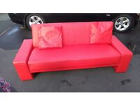 Faux leather sofa bed, only used once in excellent condition.