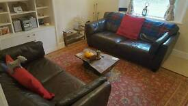 Two chocolate brown leather sofas in great condition