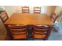 Rustic dining table and six chairs