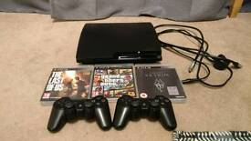PS3 Slim 500GB, 2 controllers, GTA V, Last of Us, & Skyrim