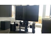 LG TV with stand,dvd and surround speakers