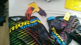 Brand new thor mx suit with gloves . Unused and still with tags on