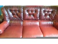 Brown/redish 3 seater leather sofa.