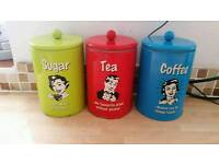 Tea, coffee, sugar canisters. £1 each.