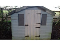 child's wooden playhouse / shed