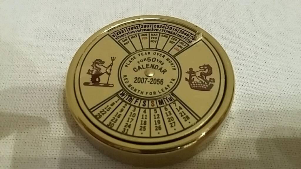 ornamental brass calendar