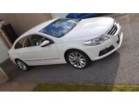 White VW Passat cc,