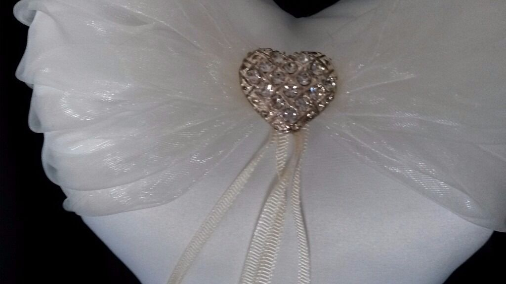 Wedding Rings Cushionin Southwater, West SussexGumtree - Handcrafted satin & lace heart diamonte with ribbons to tie rings on & ribbon strap at back to place hand through. Boxed as new excellent condition ivory colour £10.00