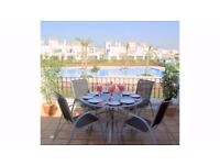 A LOVELY 2 BEDROOM 2 BATHROOM VILLA ON A BEAUTIFUL ALL YEAR HOLIDAY RESORT IN SUNNY MURCIA SPAIN.