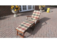 Good quality teak garden lounger, good condition, with cushion.