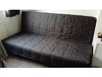 Ikea 3 seater Sofa Bed, 200cm long and when extended as bed 140cm wide. Comes with charcoal cover.