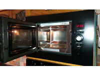 Built-in double oven, dishwasher and built-in microwave, all in black