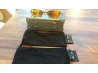 Oakley E Wire Gold Sunglasses 2 bags and metal Oakley hard case.