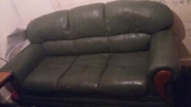 Used green 2 seater sofa free to pick up only