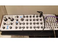 Behringer Neutron Semi Modular synth with overlay.