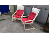 Pair of lounge chairs with cusions