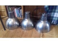 Trendy hanging lights - great for a modern style kitchen.