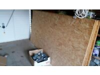 Chip Board - brand new 8@ x 4'. 1 box metal roof hangers.