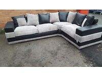 Superb Brand New large black and grey cord corner sofa. wide arms.good quality.can deliver