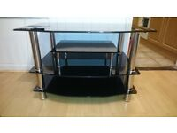 TV stand. Black glass shelves, chrome legs