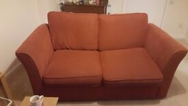 TWO SEATER SOFA AND LEATHER CHAIR