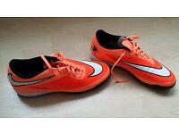 Nike orange football boots.