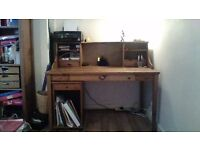 Wooden desk from Ikea in dark wood with matching removable storage unit