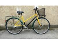 Ladies shaft drive town bike with basket hybrid