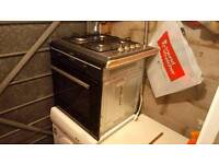 Integrated single electric oven and gas hob.
