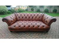 An Oskar leather Chesterfield sofa in excellent condition throughout