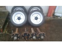 Trailer axels and wheels