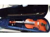 1/2 size violin, lovely condition.